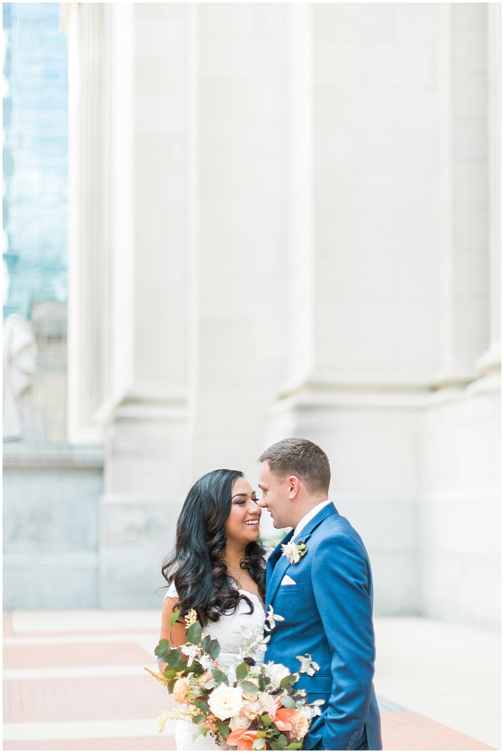lace wedding dress; bride and groom portraits; blue groom's suit; large neutral bridal bouquet; Mexican inspired gold & floral wedding; Crowne Plaza Indianapolis Downtown Union Station; neutral floral and greenery wedding|Cory + Jackie and Jessica Dum Wedding Coordination