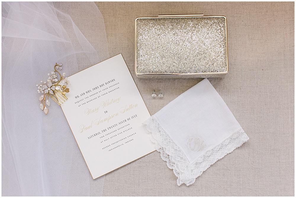 gold wedding invitations; gold clutch; wedding handkerchief; Navy + blush wedding; Scottish Rite Cathedral| Traci & Troy Photography and Jessica Dum Wedding Coordination