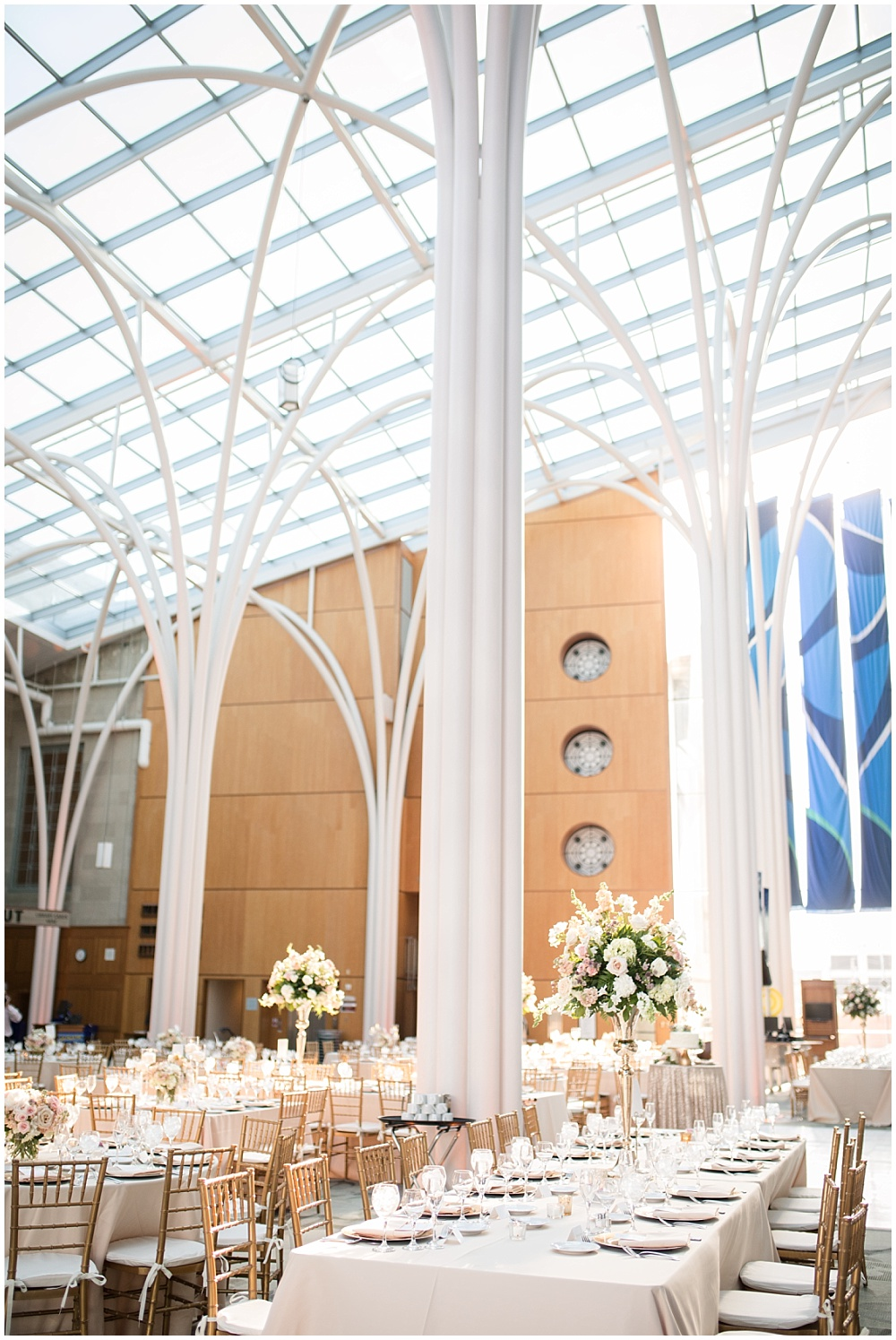 Blush wedding tablescape with a mix of high and low florals created by McNamara Florists and blush linens.   Spring blush and gold downtown Indianapolis Central Library wedding alongside Evangeline Renee Photography + Jessica Dum Wedding Coordination