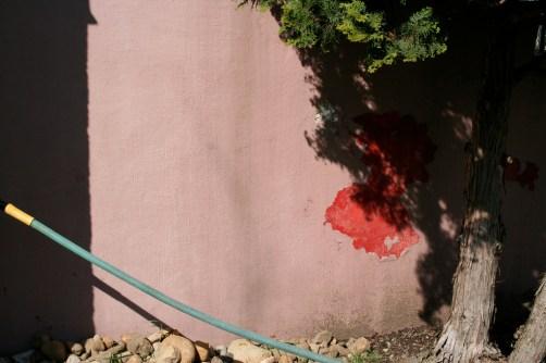 red spirit pink wall