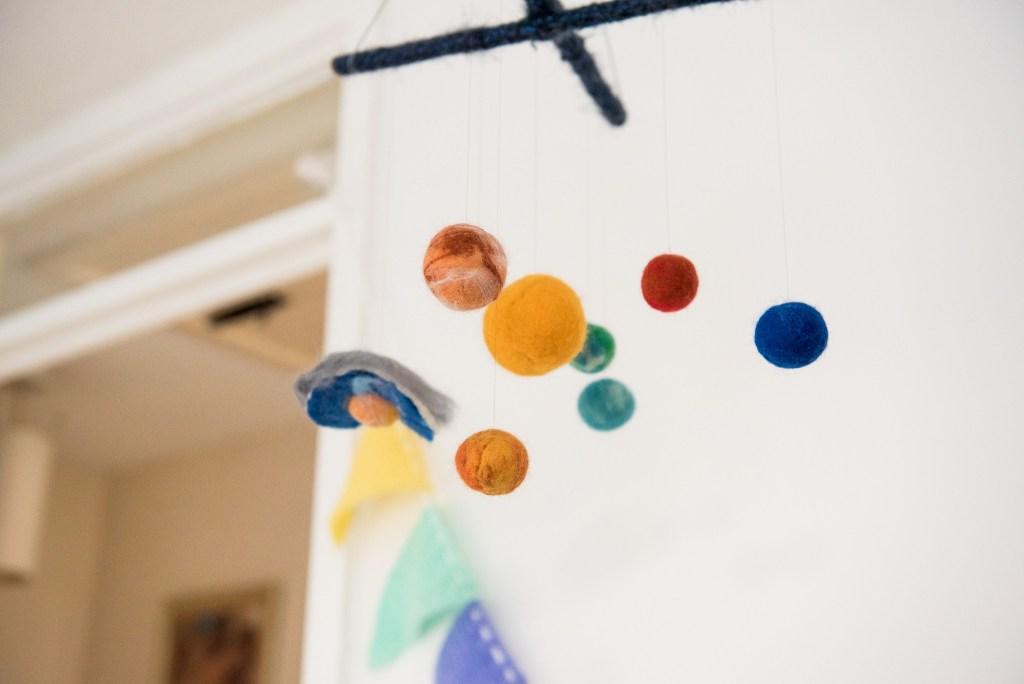Childrens colourful hanging toy Surrey family photography