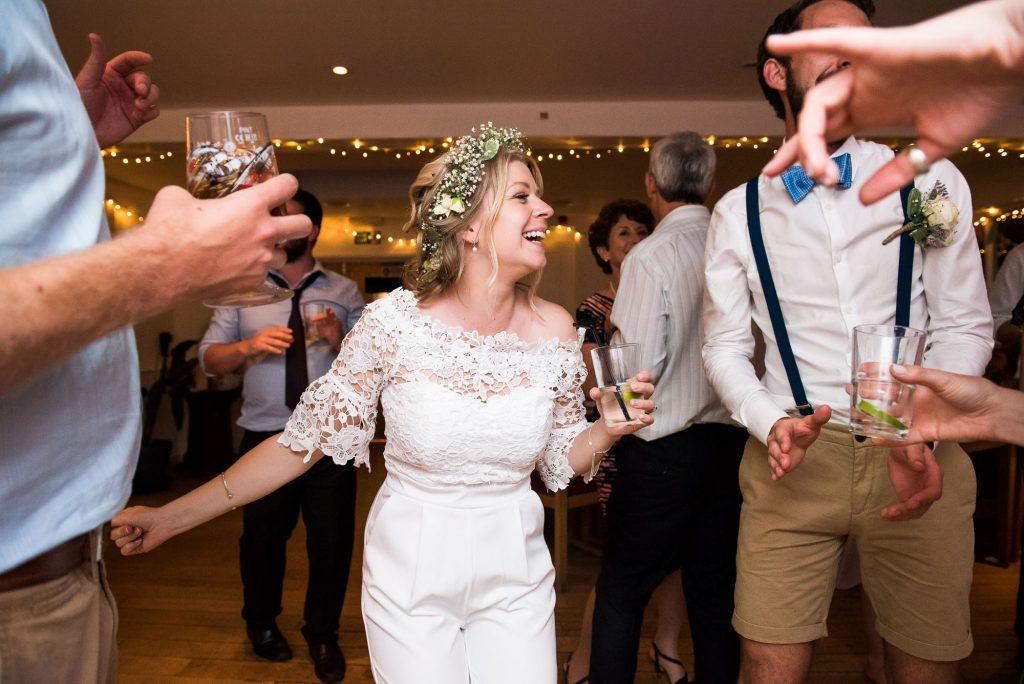 Boho bride with groom dancing to Siboney and Andy Cornwall wedding