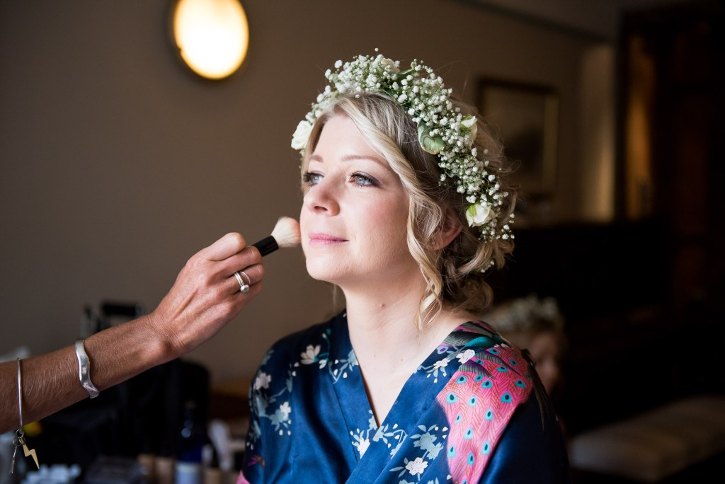 Bride wearing floral crown hair and make up by Suzi Winter Cornwall