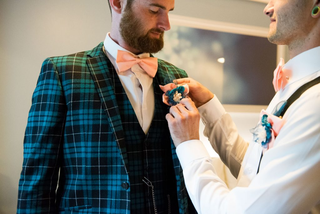 Creative groom wearing tartan suit quirky wedding