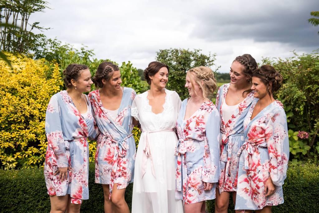 Bride with bridesmaids pre wedding photography Norfolk