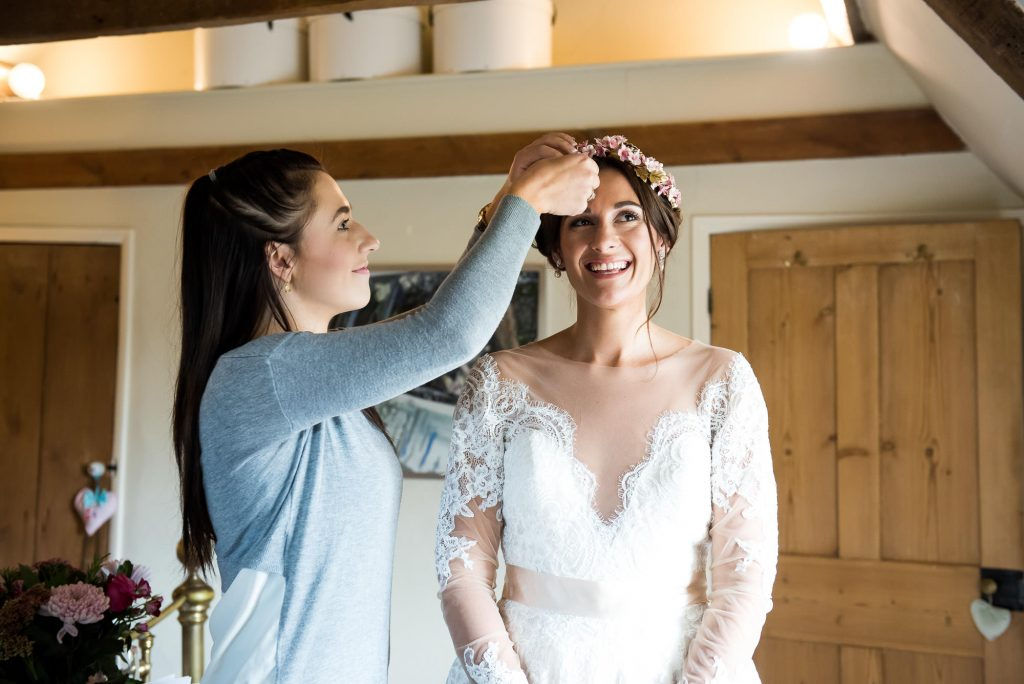 Smiling Jay West Bride wearing floral crown pre wedding photography Norfolk