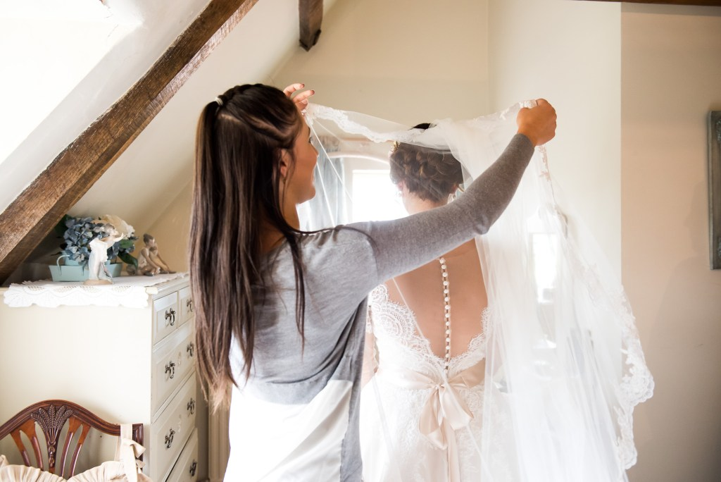 Jay West Bride pre wedding prep with flowing veil Spixworth Hall wedding