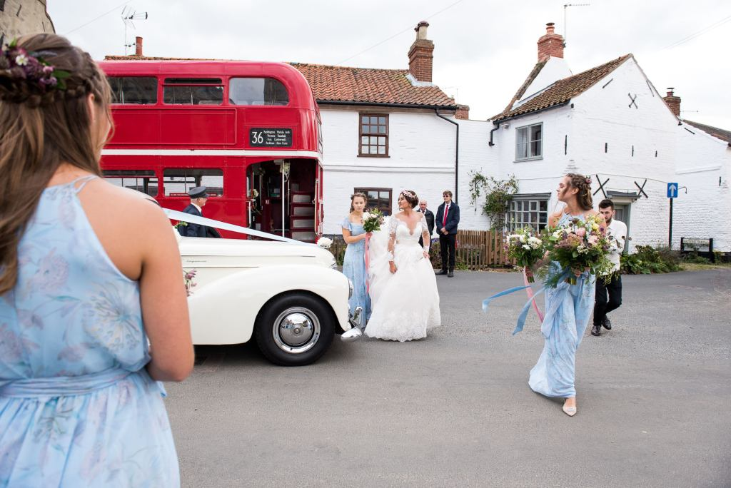 Natural wedding photography with vintage transport Spixworth Hall wedding