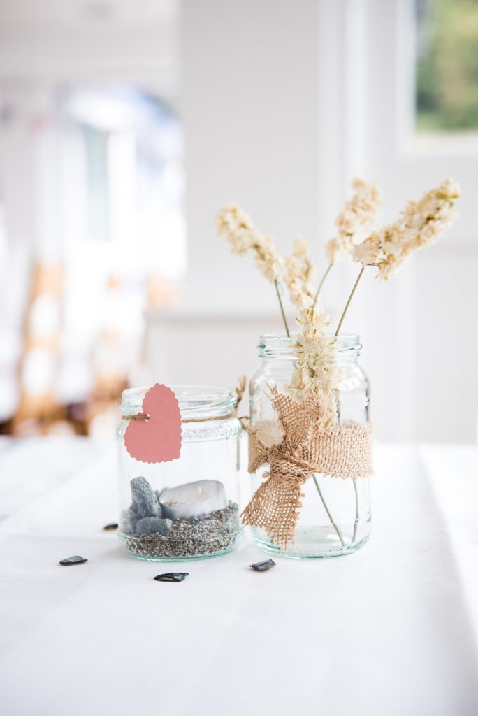 Pebbles and dried wild flower natural wedding decor Cornwall