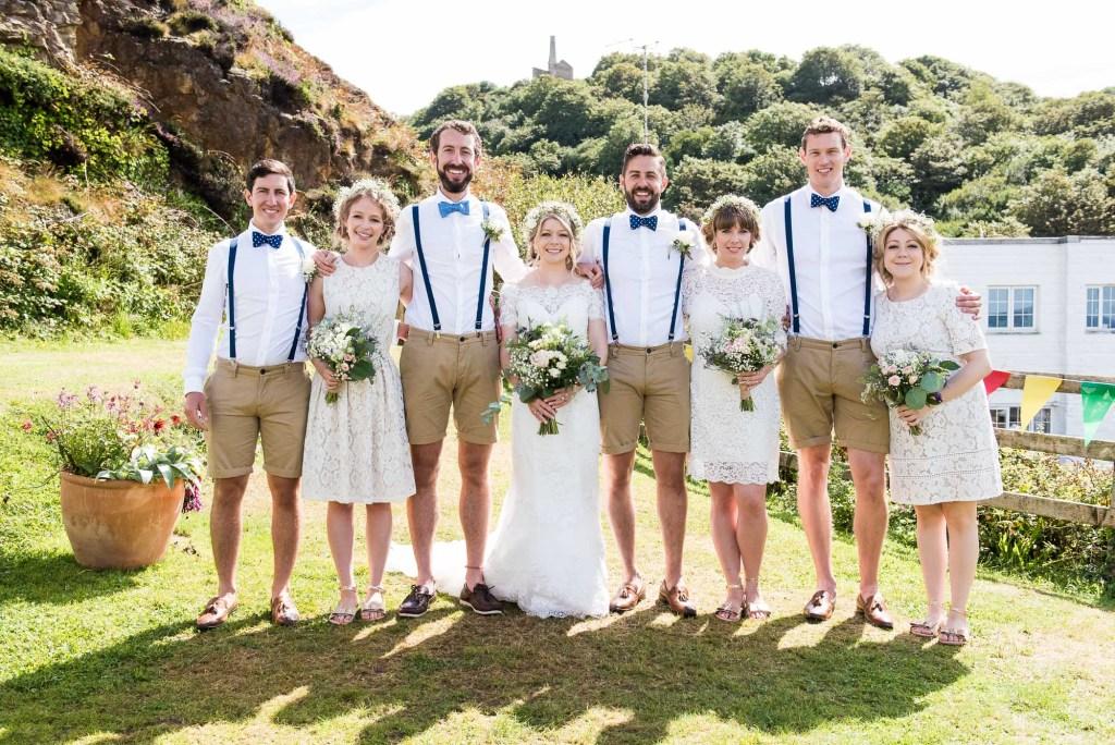 Creative boho themed wedding group portrait Driftwood Spars Wedding
