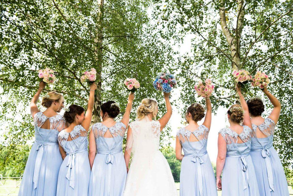 Ronald Joyce bride with Coast bridesmaids holding bouquet