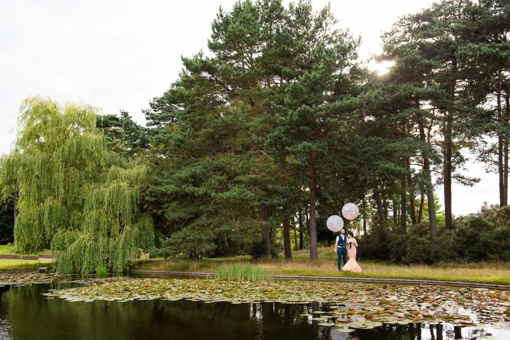 Creative wedding portrait with colourful balloons Wilde Theatre wedding Berkshire