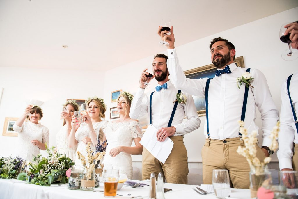Standing toast to celebrate Cornwall wedding