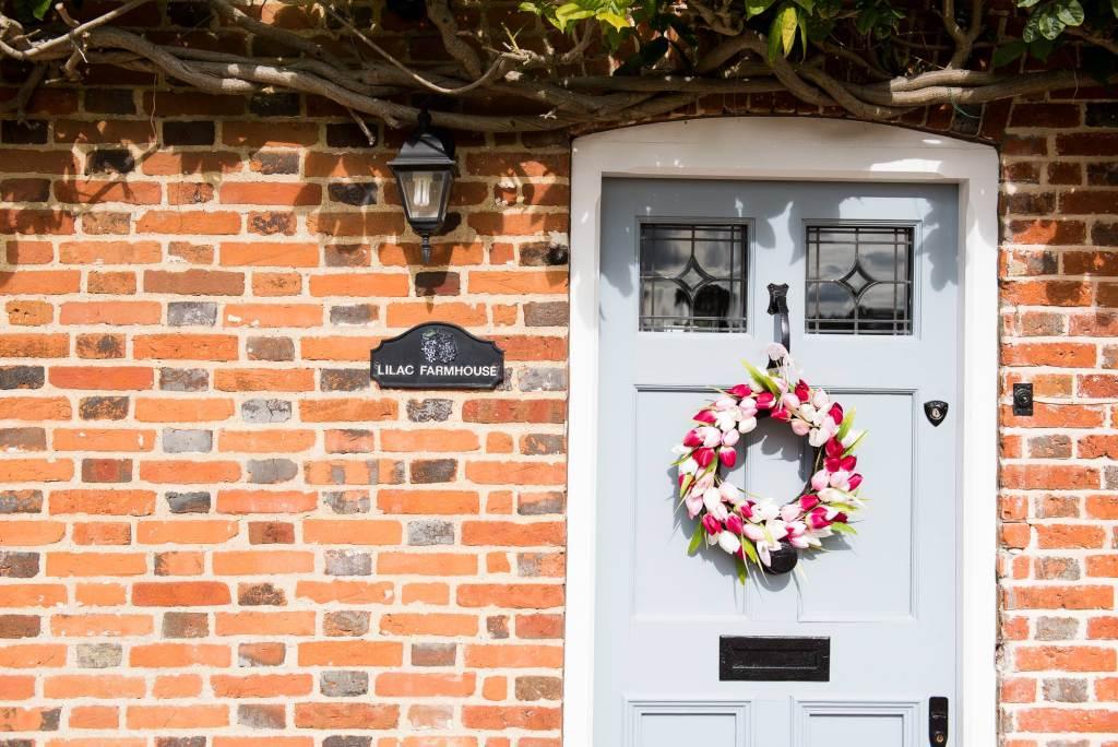 Floral decor on door pre wedding photography Norfolk