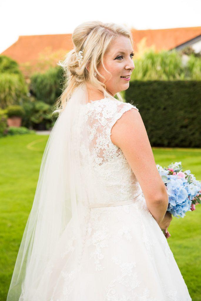 Ronald Joyce lace bride holding pastel Hannah Martin bouquet