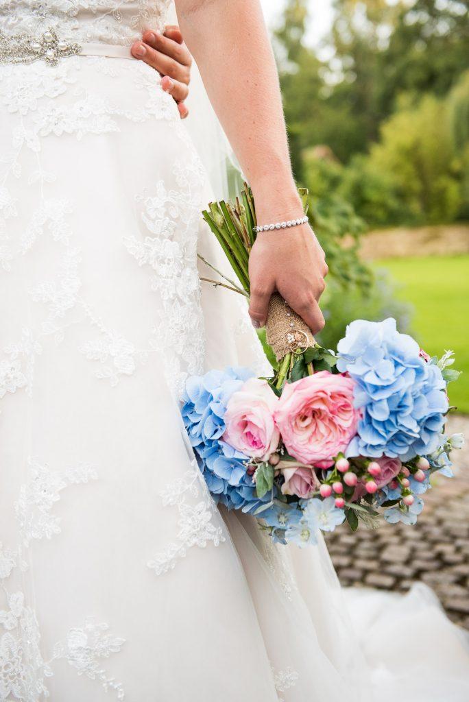 Bride holding Hannah Martin pastel bouquet