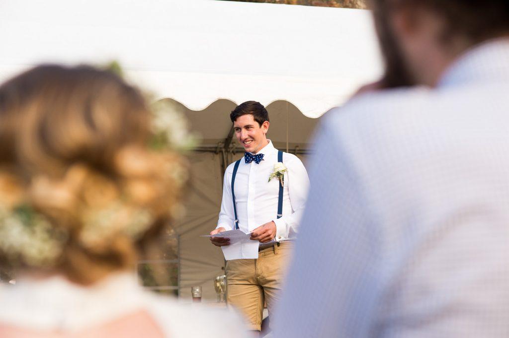 Groomsmen delivers speech outdoor Cornwall wedding