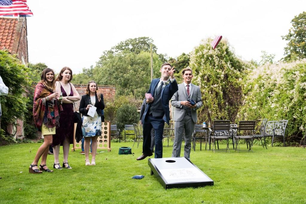 Guests play wedding game Norfolk Barn wedding