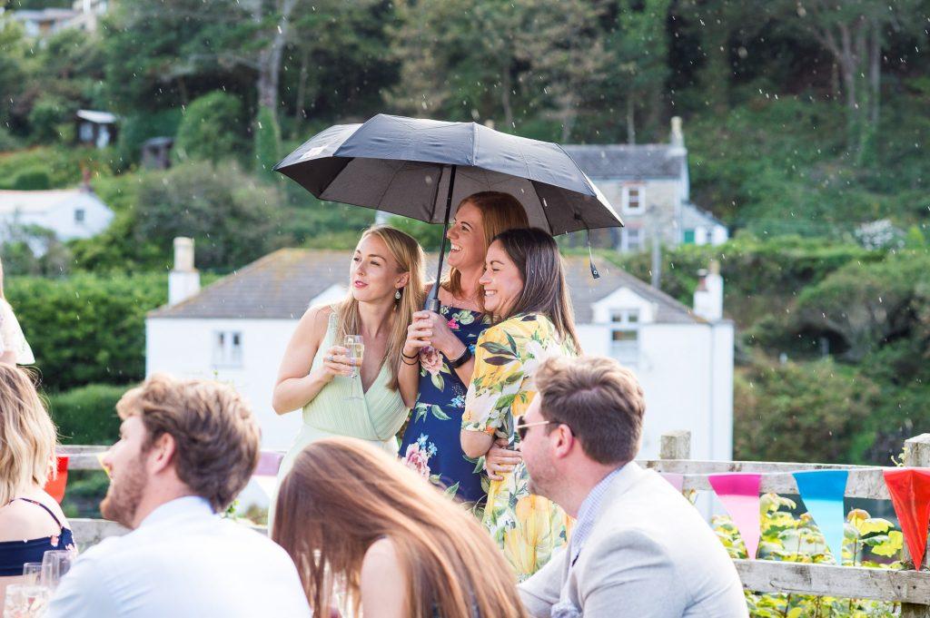 Wedding guests enjoy outdoor beach wedding Cornwall