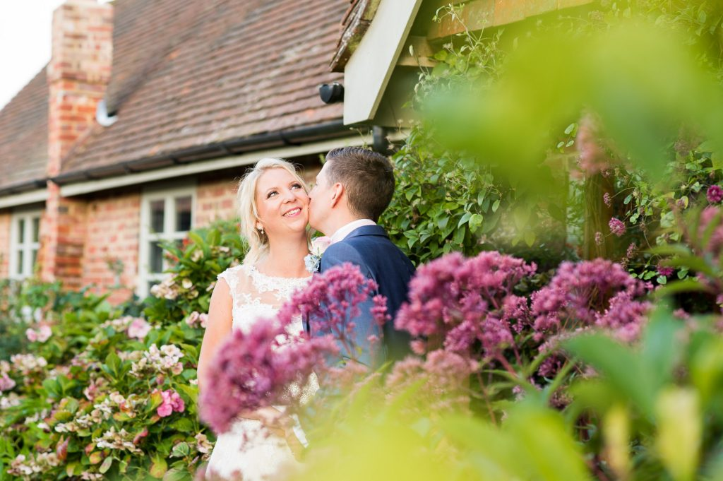 Groom kissing Ronald Joyce bride