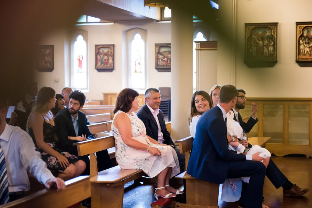 Family gather for babys christening in a Chelmsford church