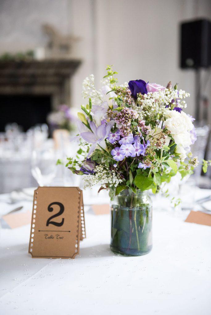 Purple floral arrangements by Wild Thyme Surrey wedding