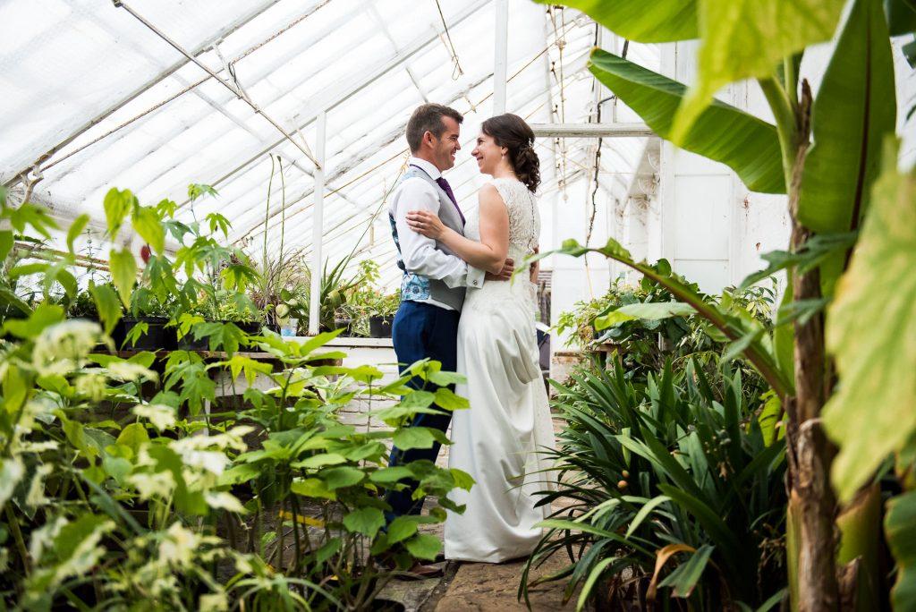 Creative wedding photography in greenhouse Surrey wedding