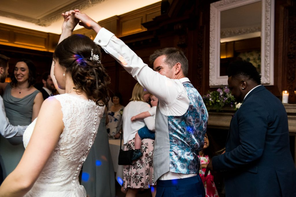 First dance for lace bride with groom wearing navy blue suit Surrey wedding