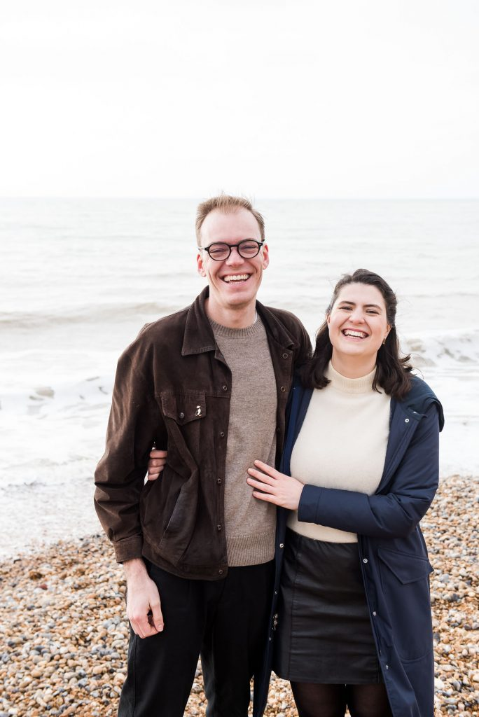 Smiling and happy couple on Brighton beach