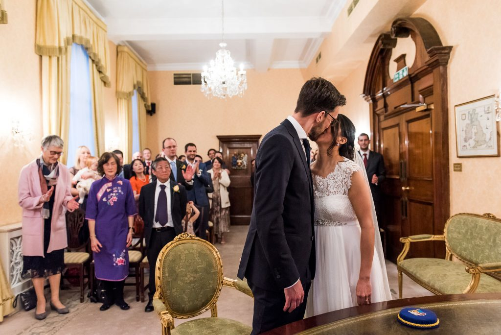 First kiss at town hall wedding London