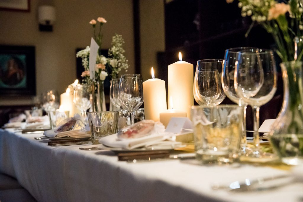 Elegant white floral arrangements with candles London wedding