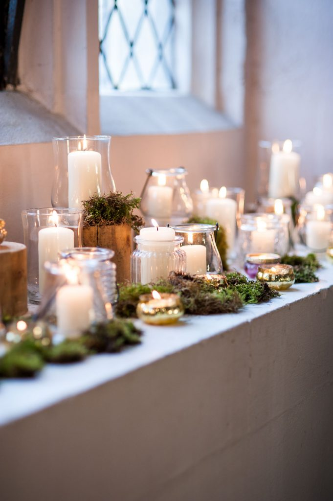 Ashridge House Wedding. Natural Wedding Photography. Hygge wedding vibes with candles filling the church