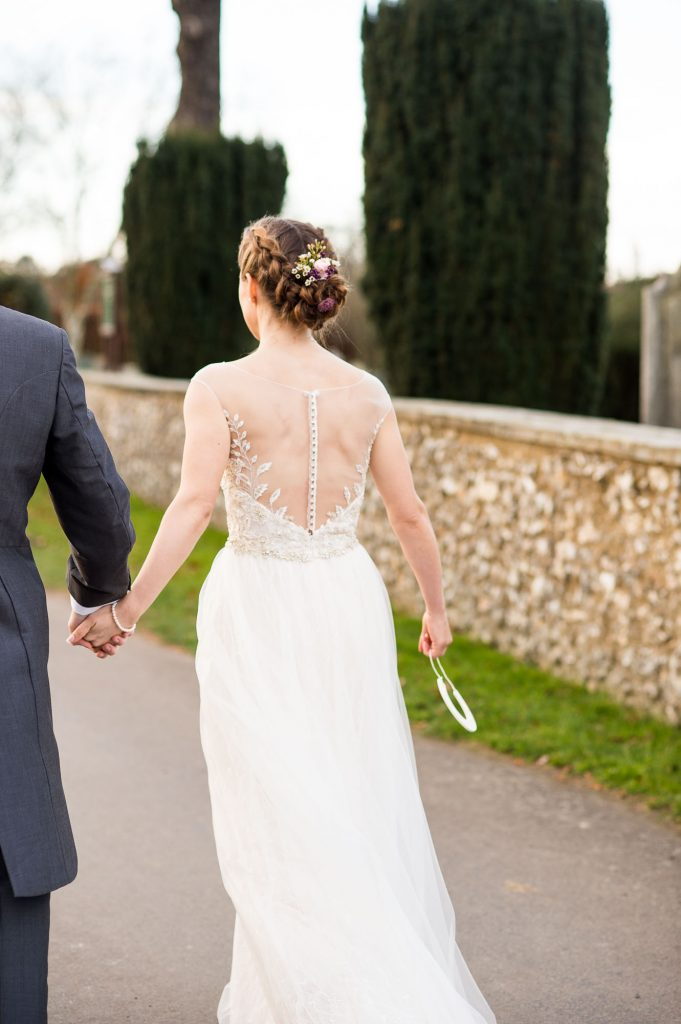 Ashridge House Wedding. Natural Wedding Photography. Gorgeous sheer lace back wedding dress from Berhamstead Brides.