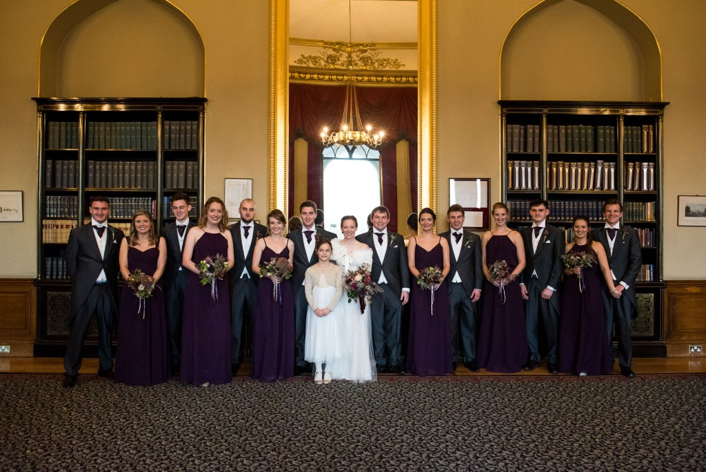 Bridal party with groomsmen at winter wedding in Ashridge House.