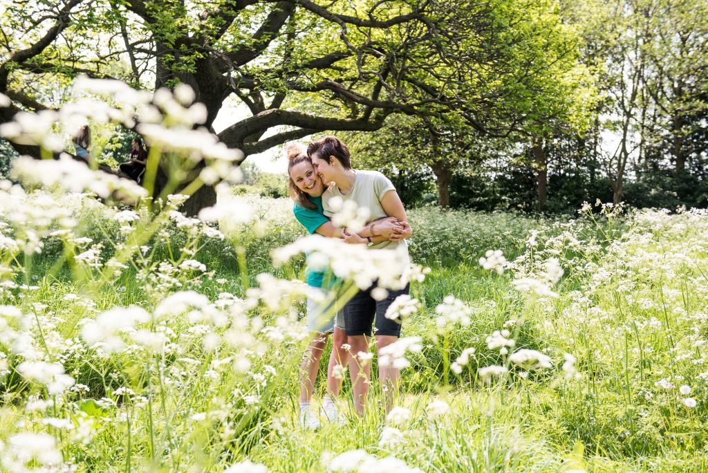 Cusworth Hall Engagement Shoot, LGBT Engagement Shoot, Couple Cuddling in the Flowers