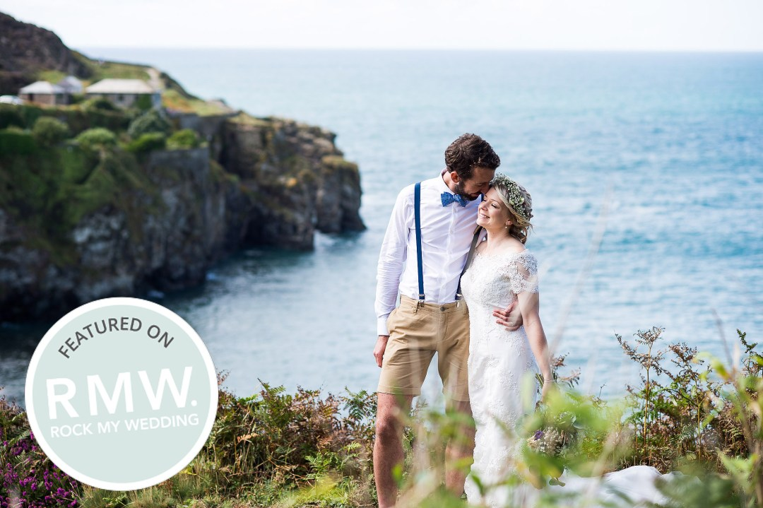 Surrey wedding photography, couple stand on a cliff top with the sea in the background