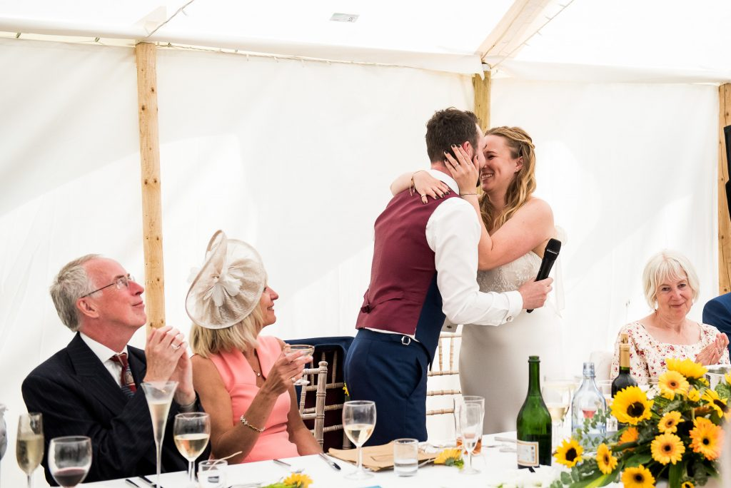 Wedding Day Timeline - Couple Embrace During Speeches - Outdoor Surrey Wedding