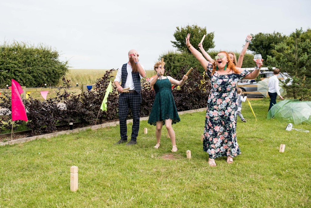 Inkersall Grange Farm Wedding - Same Sex Wedding Photography - Guests Playing Scandinavian Game KUBB
