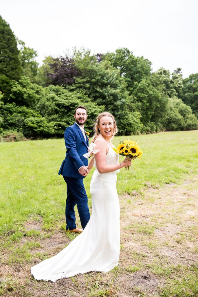 Outdoor Wedding Ceremony, Surrey Wedding Photography, Gorgeous Catherine Deane Bride and Groom Walk Across Field To Reception