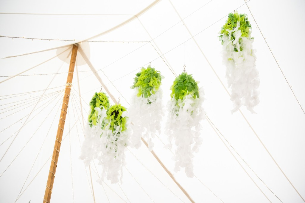 Outdoor Wedding Ceremony, Surrey Wedding Photography, Wedding Marquee Decorated with Green and White Flowers and Decor
