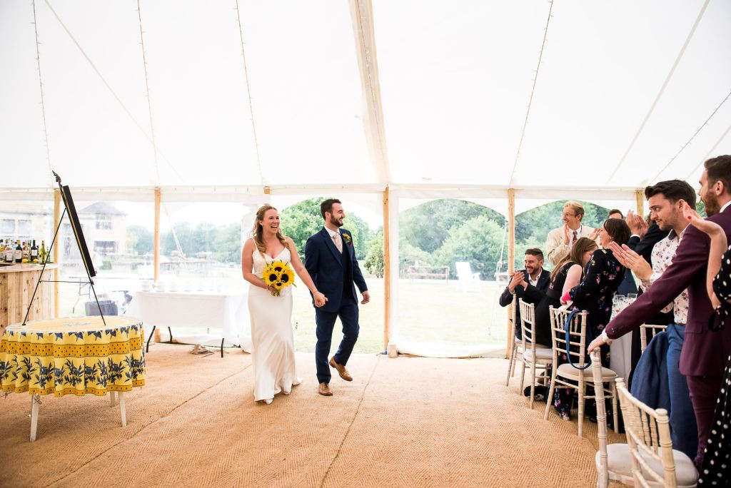 Bride and Groom Walk into Their Marquee Wedding Reception