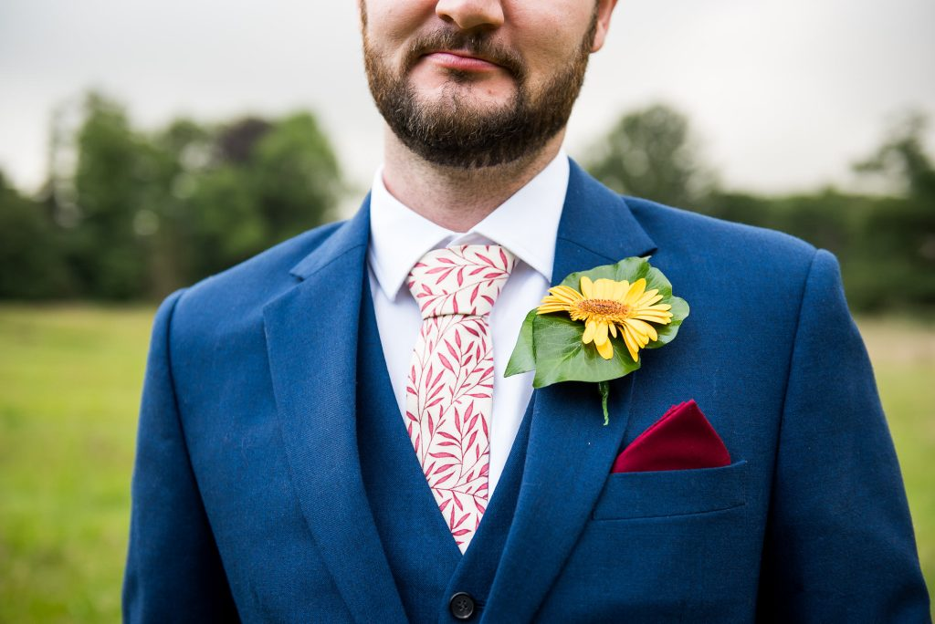 Outdoor Wedding Ceremony, Surrey Wedding Photography, Handsome Groom In Three Piece Navy Blue Suit With Yellow Flower Button Hole