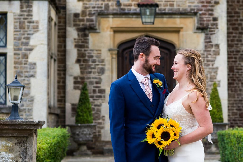 Outdoor Wedding Ceremony, Surrey Wedding Photography, Gorgeous Catherine Deane Bride and Groom Smile At Each Other Lovingly