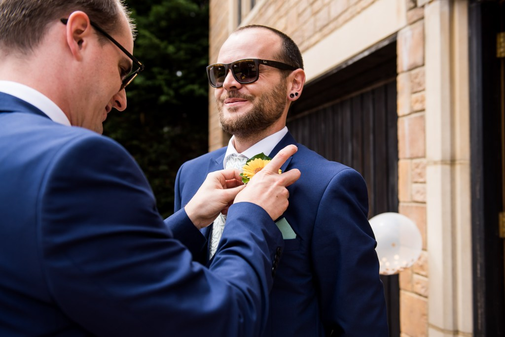 Outdoor Wedding Ceremony, Surrey Wedding Photography, Groomsmen Has His Button Hole Applied