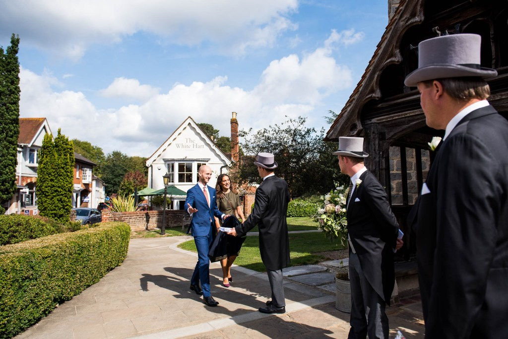 Outdoor Wedding Photography Surrey, Guests Arriving At Chobham Church In The Sunshine, Surrey Wedding Photography