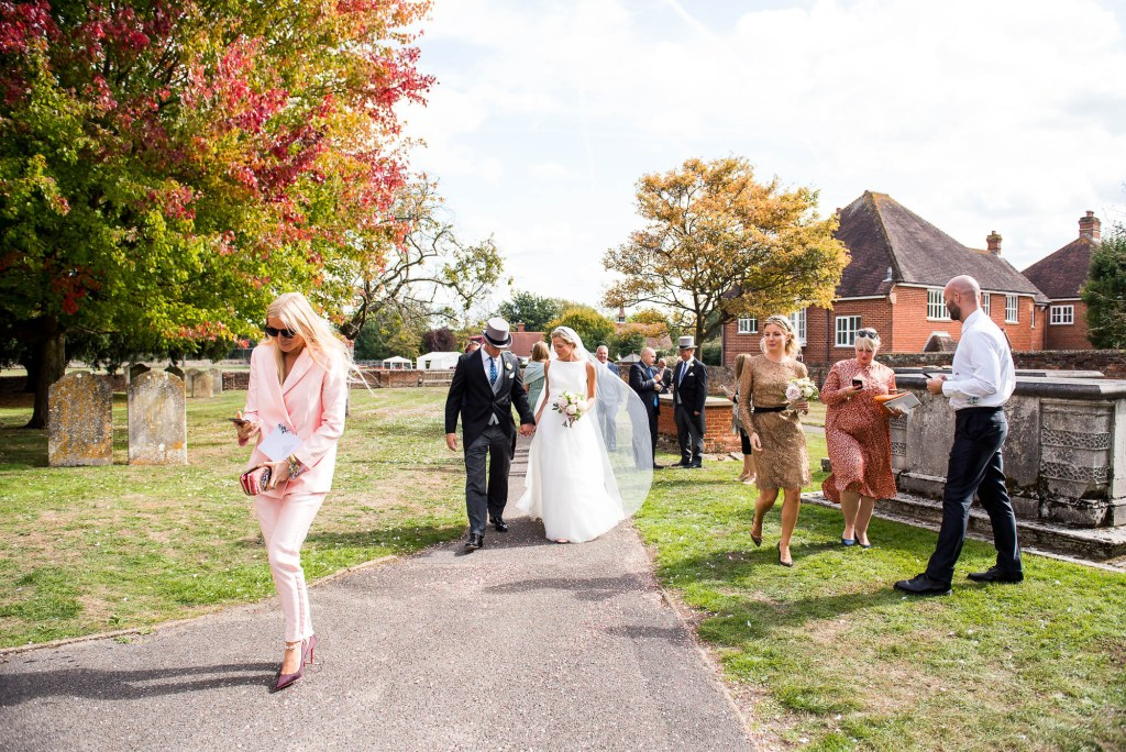 Outdoor Wedding Photography Surrey, Guests Walk From The Church To The Garden Reception