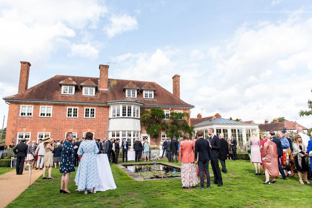Outdoor Wedding Photography Surrey, Guests Enjoy A Gorgeous Garden Reception