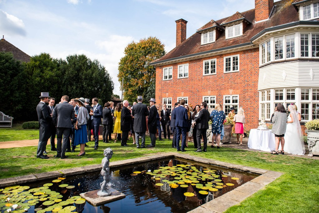 Outdoor Wedding Photography Surrey, Guests Enjoy A Gorgeous Garden Reception