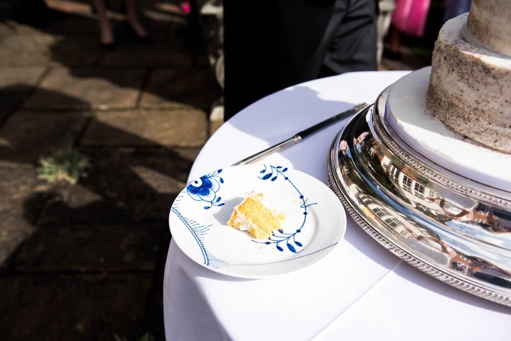 Outdoor Wedding Photography Surrey, A Slice of Wedding Cake On Royal Copenhagen China