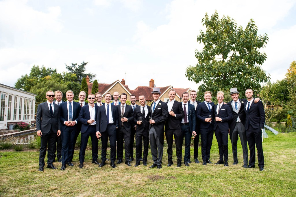 Outdoor Wedding Photography Surrey, Groomsmen Party Stand For A Group Photograph